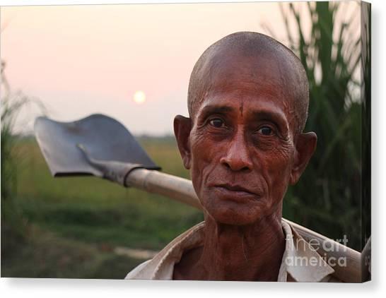 Man With Shovel Canvas Print