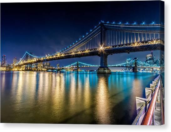 Manhattan And Brooklyn Bridges At Night. Canvas Print