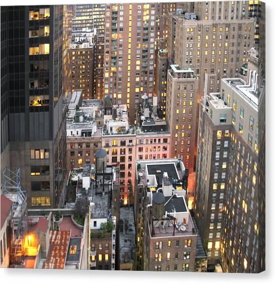 Canvas Print featuring the photograph Manhattan At Dusk by Bob Slitzan