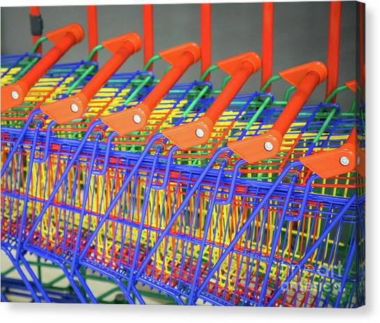 Rainbow Six Canvas Print - Many Shopping Colorful Shopping Trolleys by Shaun Wilkinson