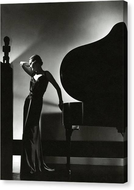 Indoors Canvas Print - Margaret Horan Posing Beside A Piano by Edward Steichen