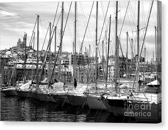 Masts In The Harbor Canvas Print by John Rizzuto