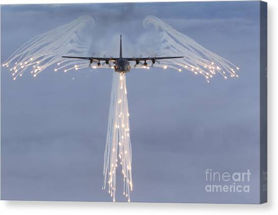 Canvas Print featuring the photograph Mc-130h Combat Talon Dropping Flares by Gert Kromhout