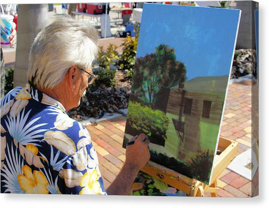 Me At Work Painting The Building With My Studio In It Canvas Print by Charles Peck