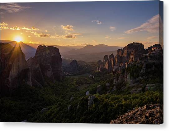 Canvas Print featuring the photograph Meteora Sunset by Nikos Stavrakas