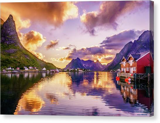 Midnight Sun Reflections In Reine Canvas Print