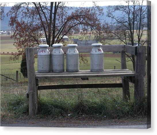 Milk Cans Waiting For Pickup Canvas Print by Jeanette Oberholtzer