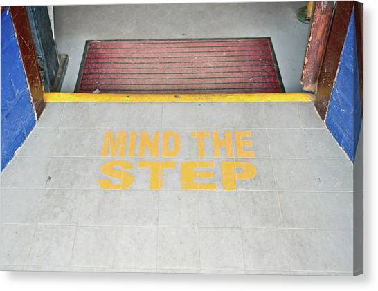 Caution Canvas Print - Mind The Step Notice by Tom Gowanlock