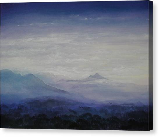Mist Over The Mountains Canvas Print by Jeff Knott