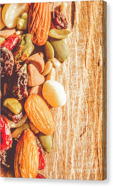 Medicine Canvas Print - Mixed Nuts On Wooden Background by Jorgo Photography - Wall Art Gallery