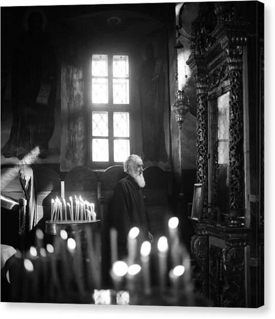 Monk And Candles Canvas Print