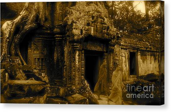 Monks Leaving Angkor Wat Canvas Print by Louise Fahy