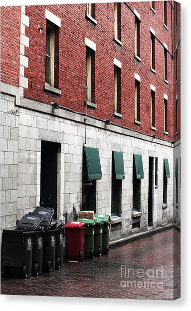 Montreal Garbage Cans Canvas Print by John Rizzuto