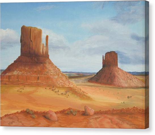 Monument Valley    The Mittens Canvas Print by Philip Hall