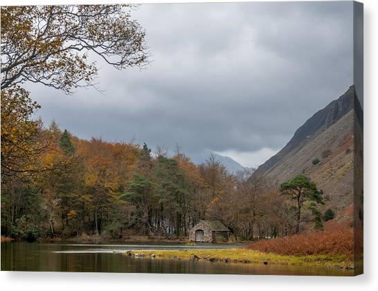 Moody Clouds Over A Boathouse On Wast Water In The Lake District Canvas Print
