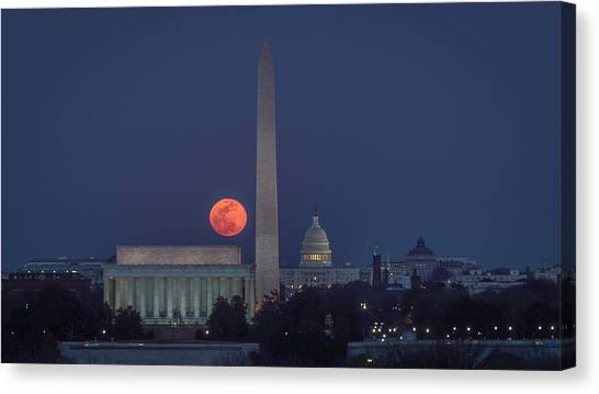 Moon Over Monuments Canvas Print by Michael Donahue