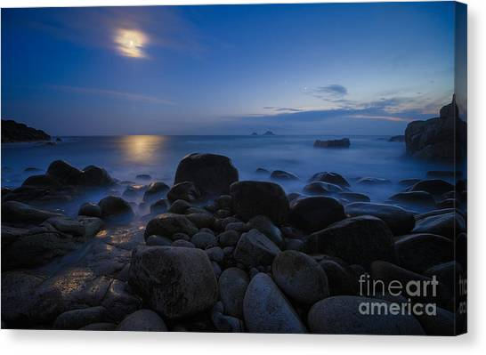Moon Over Rocks At The Shore Canvas Print by Royce Howland