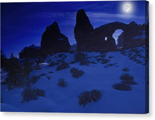 Moon Over Turret Arch Canvas Print by Douglas Pulsipher