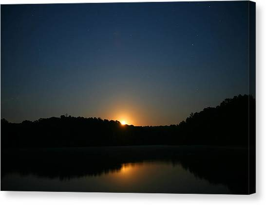 Moon Rising Over The Lake Canvas Print by James Jones