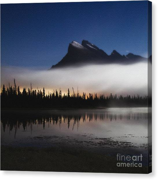 Moonlight And Town Lights Canvas Print by Royce Howland