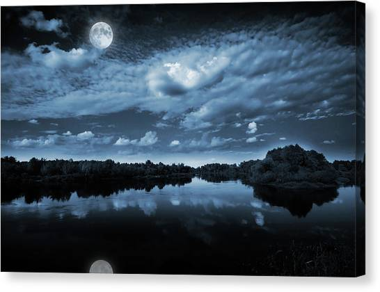 Blue Sky Canvas Print - Moonlight Over A Lake by Jaroslaw Grudzinski