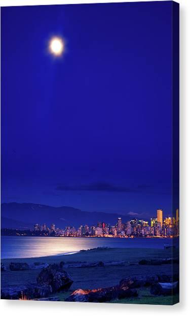 Moonlit Vancouver Canvas Print by Paul Kloschinsky