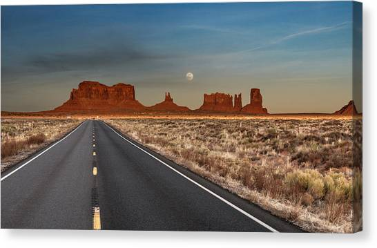 Canvas Print featuring the photograph Moonrise Over Monument Valley by Lou Novick