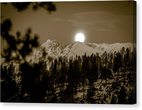 moonset over the Rockies Canvas Print