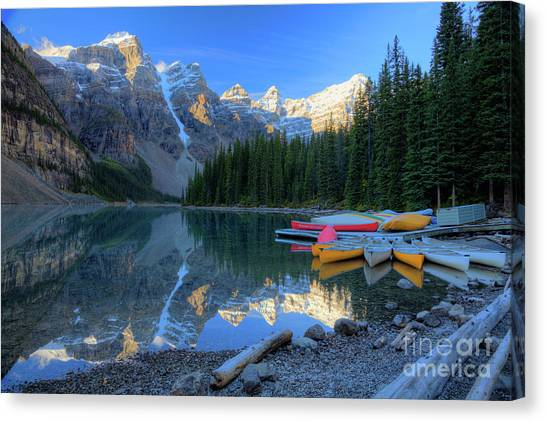 Moraine Lake Sunrise Blue Skies Canoes Canvas Print