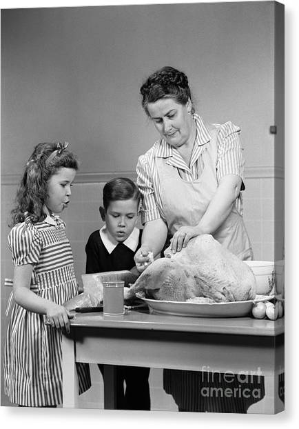 Stuffing Canvas Print - Mother Stuffing Thanksgiving Turkey by H. Armstrong Roberts/ClassicStock