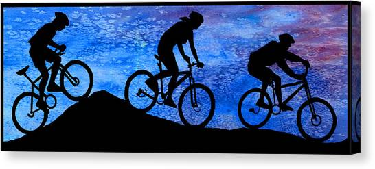 Mountain Bikers At Dusk Canvas Print