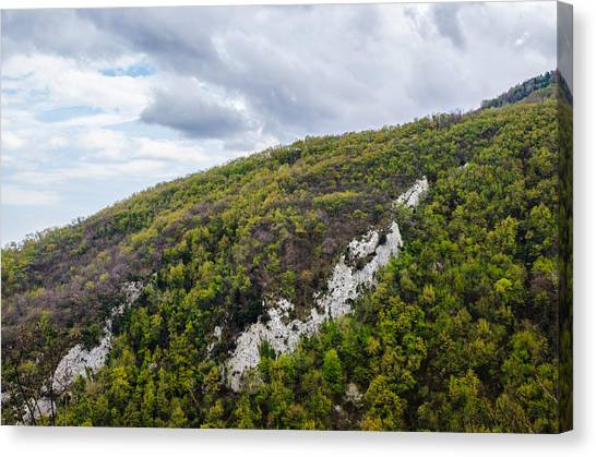 Mountains And Skies Canvas Print by Andrea Mazzocchetti