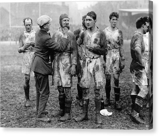 Muddy Players Canvas Print by Hulton Collection