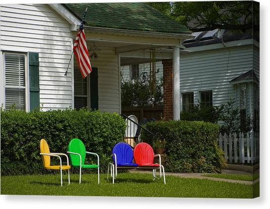 Mls Canvas Print - Multi-colored Chairs In The Front Yard With Flag by Scott Hales