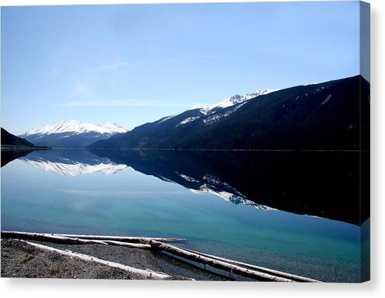 Muncho Lake Reflections Canvas Print by Dave Clark