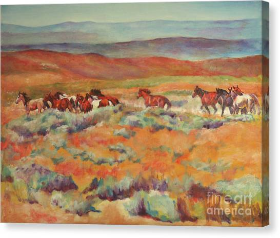Mustangs Running Near White Mountain Canvas Print by Karen Brenner