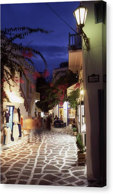 Mykonos Town At Night Canvas Print by Steve Outram