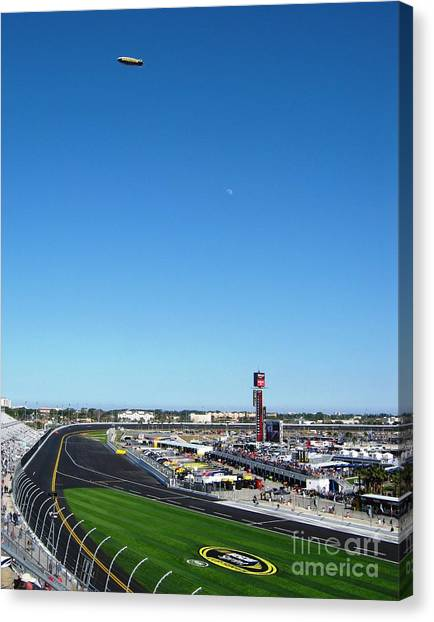 Daytona 500 Canvas Print - Nascar Blimp And Moon by Lesley Giles