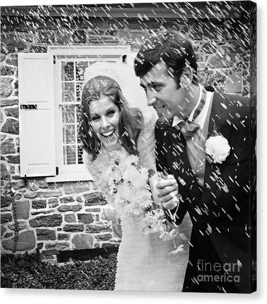 Wedding Gown Canvas Print - Newlyweds Showered With Rice, C.1960-70s by H. Armstrong Roberts/ClassicStock