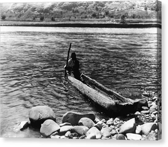 Nez Perc� Canoe. Nez Perc� Man Canvas Print by Everett
