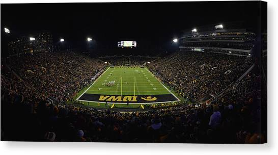 University Of Nebraska Canvas Print - Night Game At Kinnick Stadium by Ben Ford