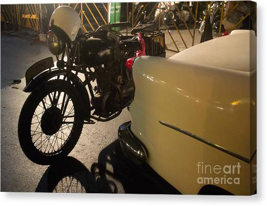 Night Time Silhouette Of Vintage Motorcycle Near Tail Of 50's St Canvas Print