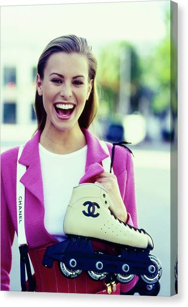 Roller Skating Canvas Print - Niki Taylor In A Chanel Outfit With Roller Blades by Arthur Elgort
