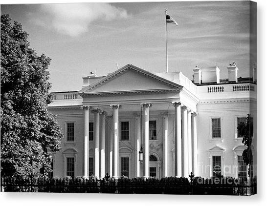 Whitehouse Canvas Print - north facade of the White House with flag flying Washington DC USA by Joe Fox