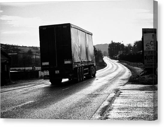 Brexit Canvas Print - northern ireland freight traffic crossing the irish border between Northern Ireland and Republic of  by Joe Fox