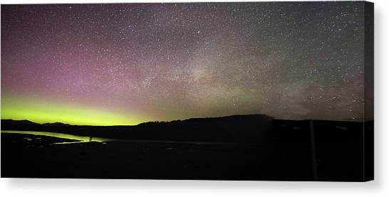 Canvas Print featuring the photograph Northern Lights And Milky Way In Yellowstone Np by Jean Clark