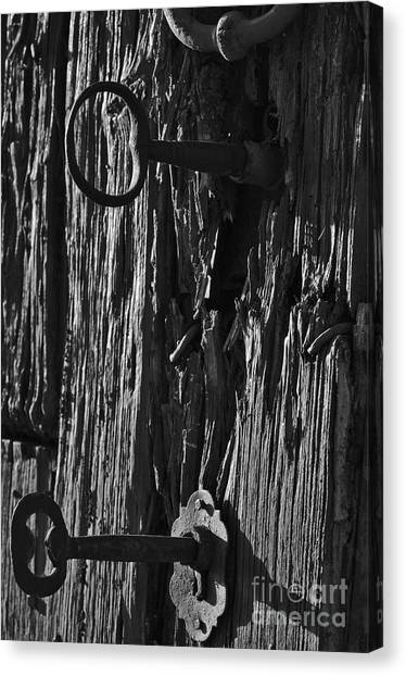 Old And Abandoned Wooden Door With Skeleton Keys Canvas Print