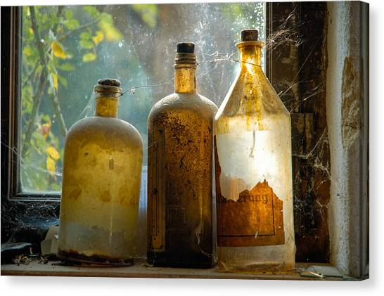 Old And Dusty Glass Bottles Canvas Print by Matthias Hauser