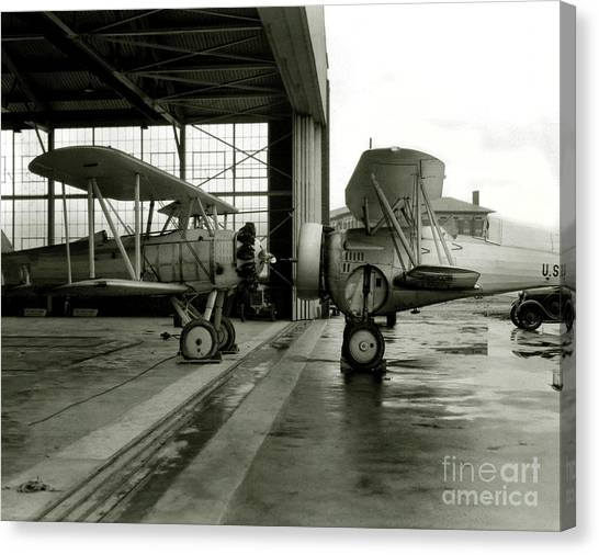 Prop Planes Canvas Print - Old Biplanes In A Hanger  by Jon Neidert