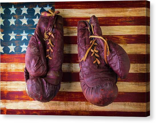 Knockout Canvas Print - Old Boxing Gloves On American Flag by Garry Gay